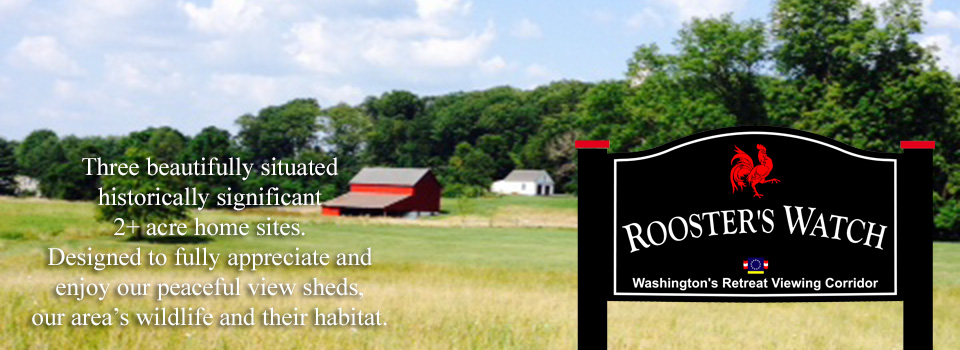 A large field with a barn and house in the distance. Rooster's Watch Sign. 3 beautifully situated historically significant 2+ acre home sites. Designed to fully appreciate and enjoy our peaceful view sheds, our area's wildlife and their habitat.